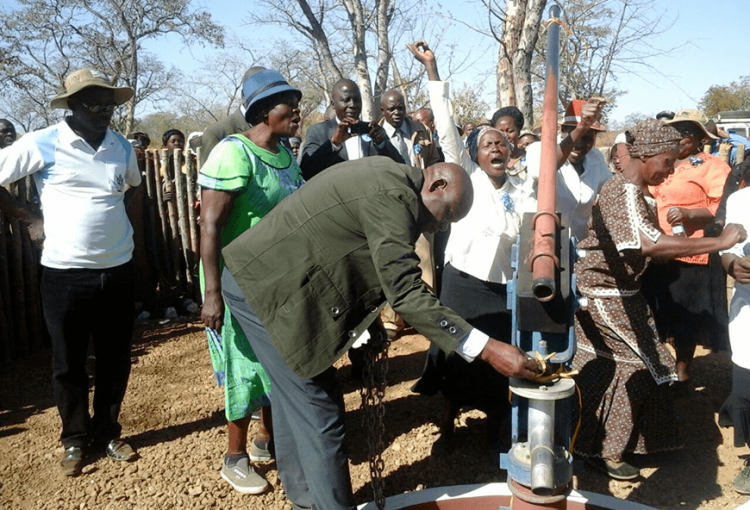 people celebrating the handover of a borehole in Bubi, Matebeleland North Province, Zimbabwe